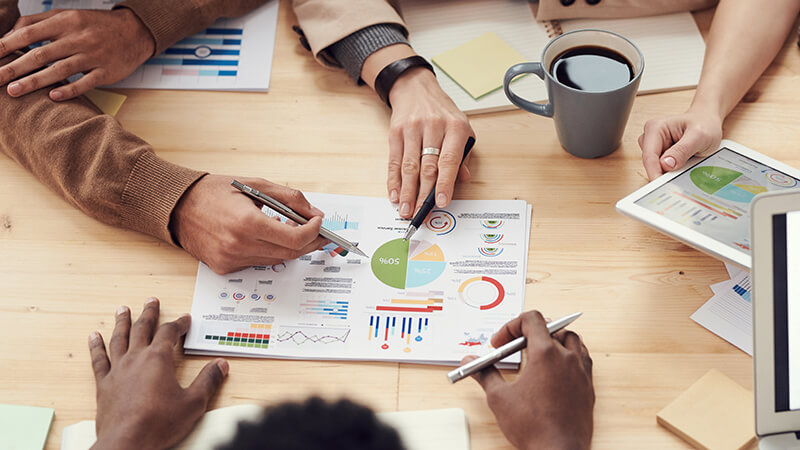 Business owners planning and making financial decisions in a meeting